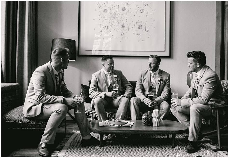 Groom and Groomsmen having a drink before the ceremony at a Hampton Manor wedding