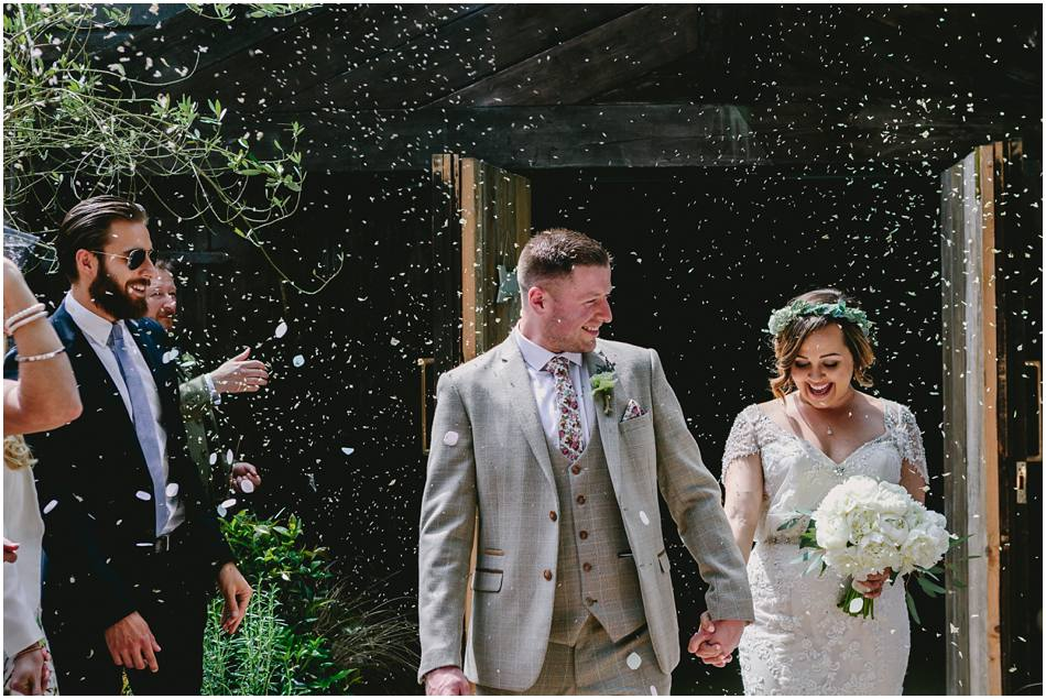 Bride and Groom walk out to confetti being thrown