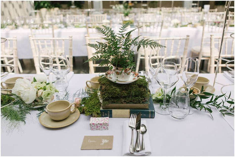 Moss, ferns and book table centres; secret garden inspired wedding