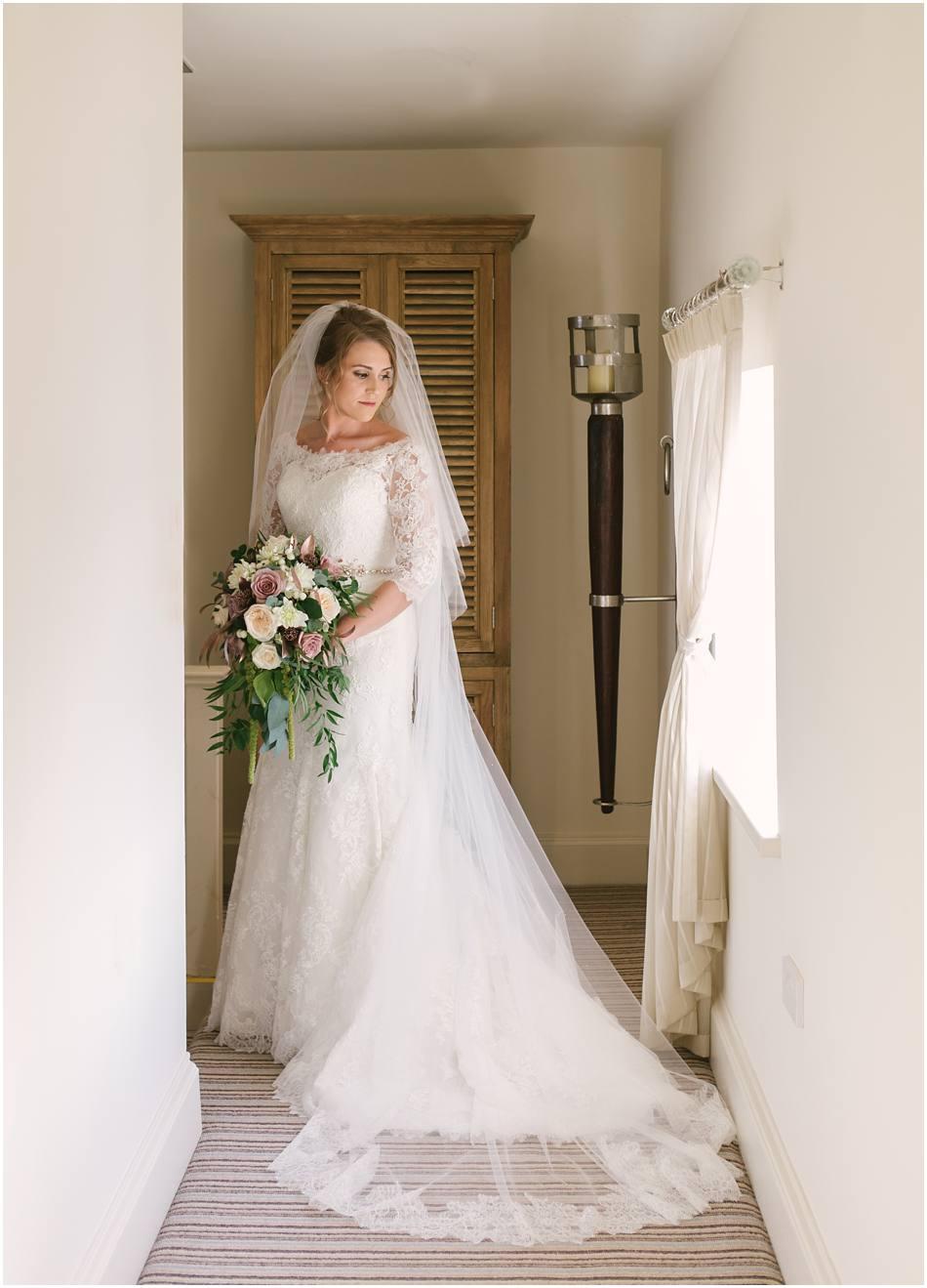 Modern Alrewas Hayes wedding; portrait of a Bride wearing a long sleeved lace wedding dress
