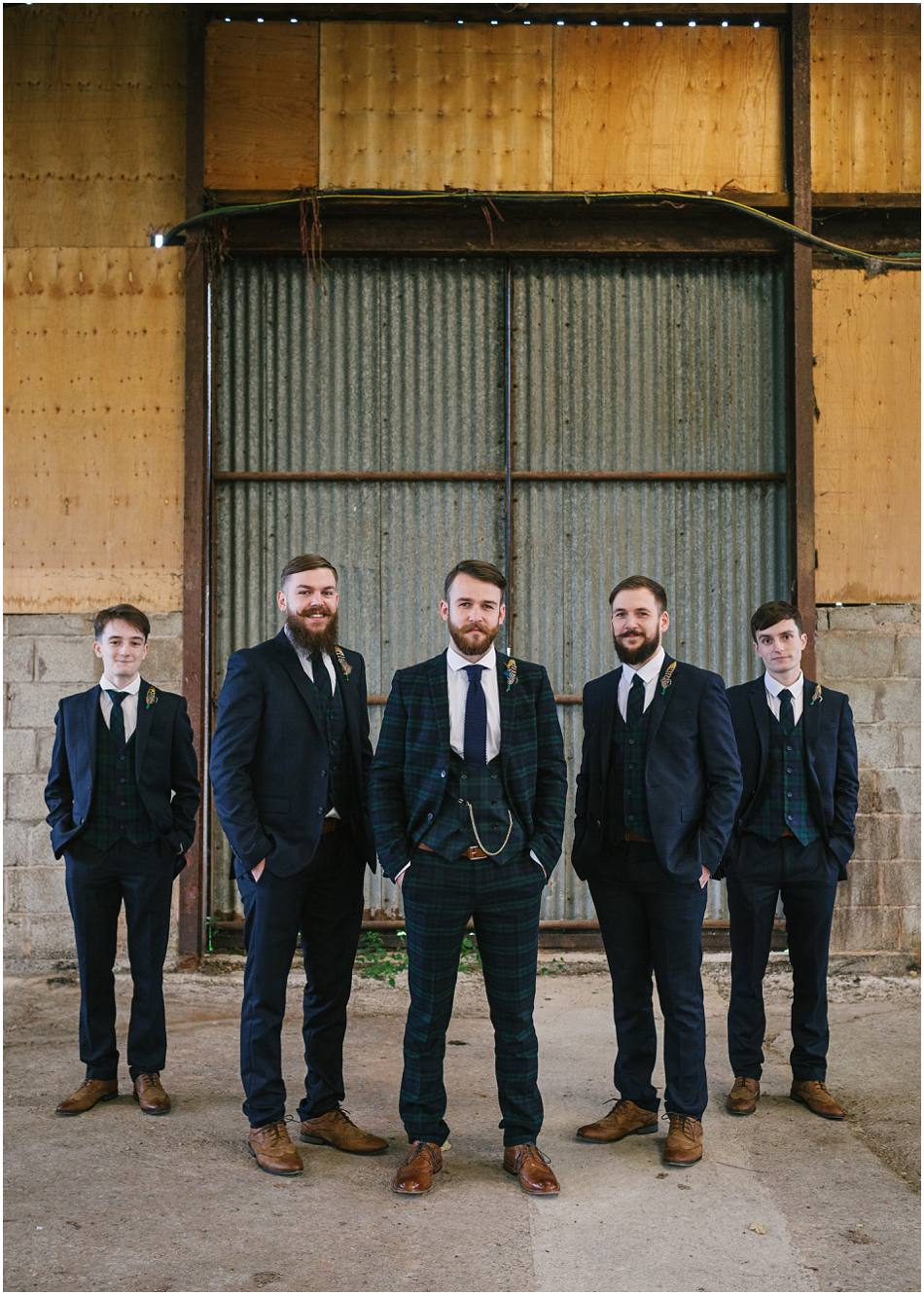 Portrait of a Groom with his Groomsmen on his wedding day at Curradine Barns