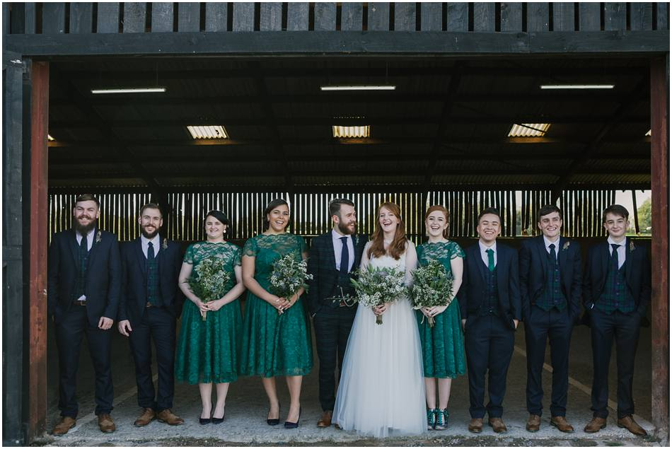 Relaxed bridal party group photo at Curradine Barns