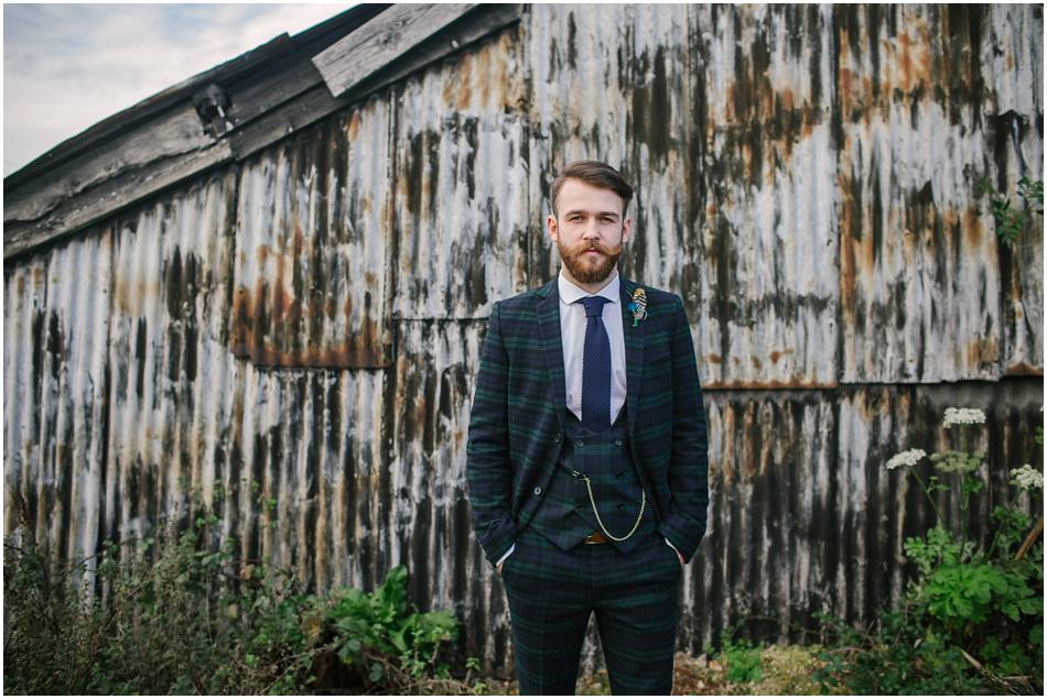 Portrait of a Groom with beard and dark green tartan check suit