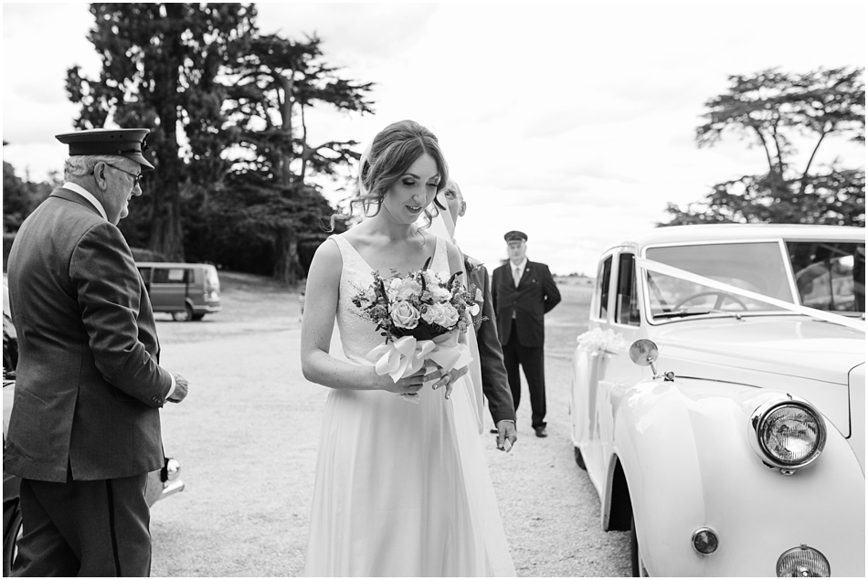 Bride arriving in the wedding car in front of Compton Verney in Warwickshire