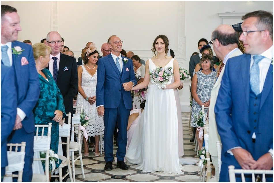 Bride and her Dad walking down the aisle at Compton Verney