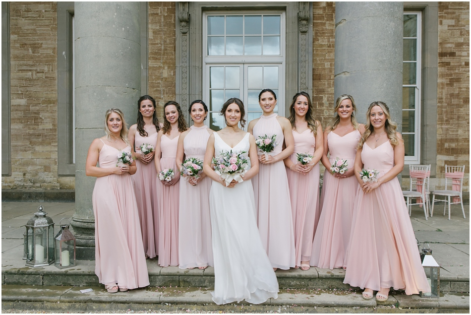 Compton Verney wedding photography; Bride and Bridesmaids wearing blush pink dresses with pastel rose bouquets