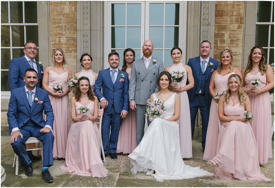 Compton Verney wedding photography; Modern group photo of the Bridal Party under the collonade