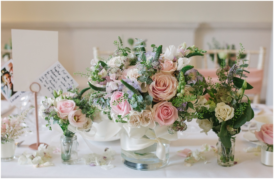 pastel table centres, with pink roses and green foliage at a Compton Verney wedding