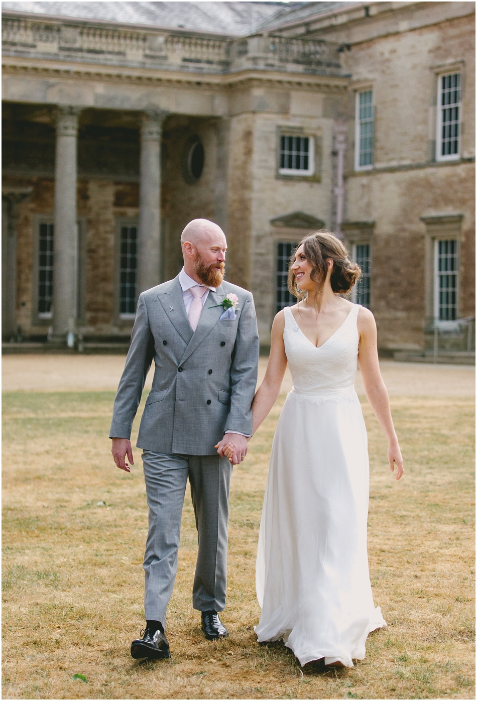 Compton Verney wedding photography;Bride and Groom walking in the grounds holding hands