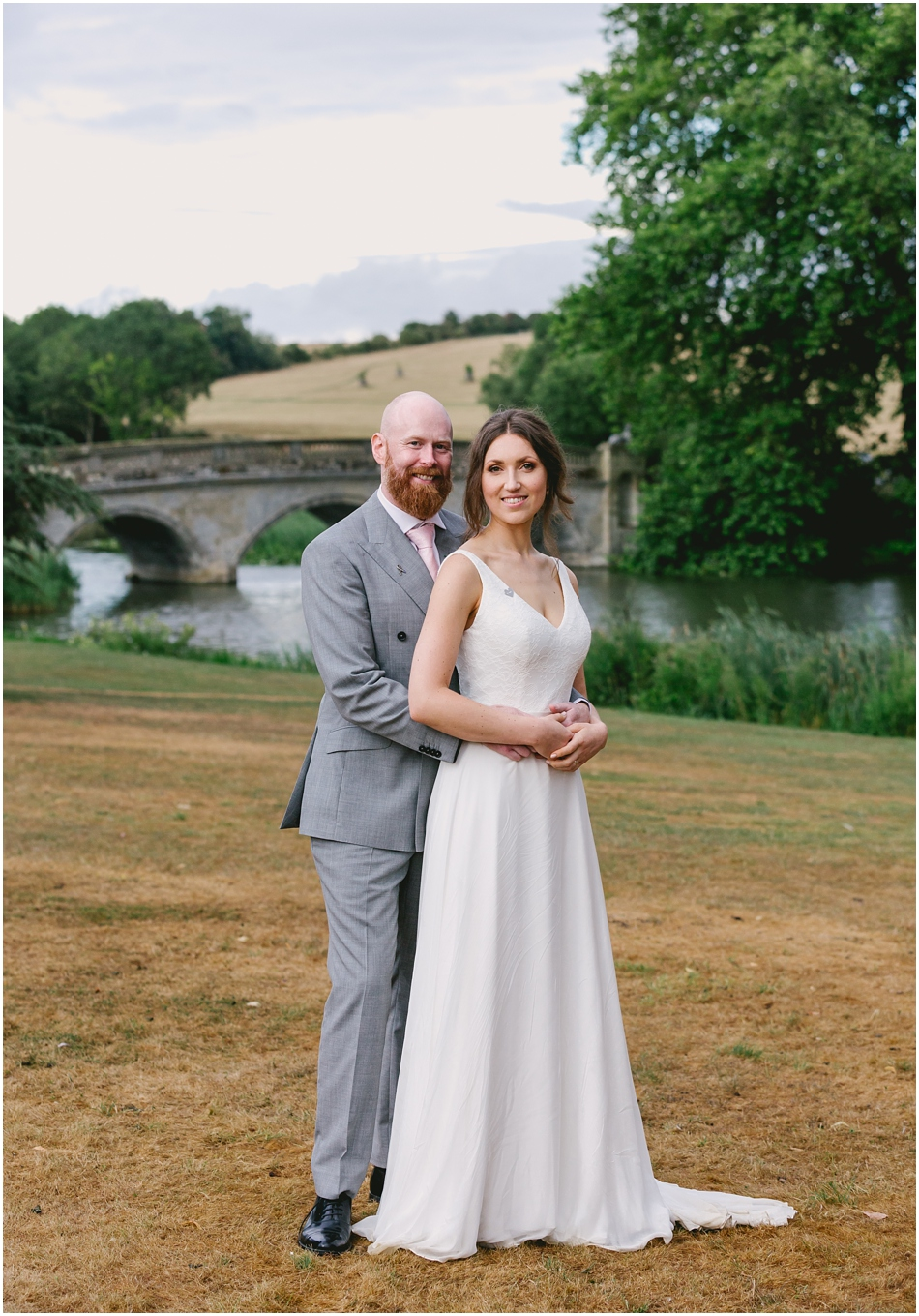 Bride and Groom in front of the bridge at their Compton Verney Wedding