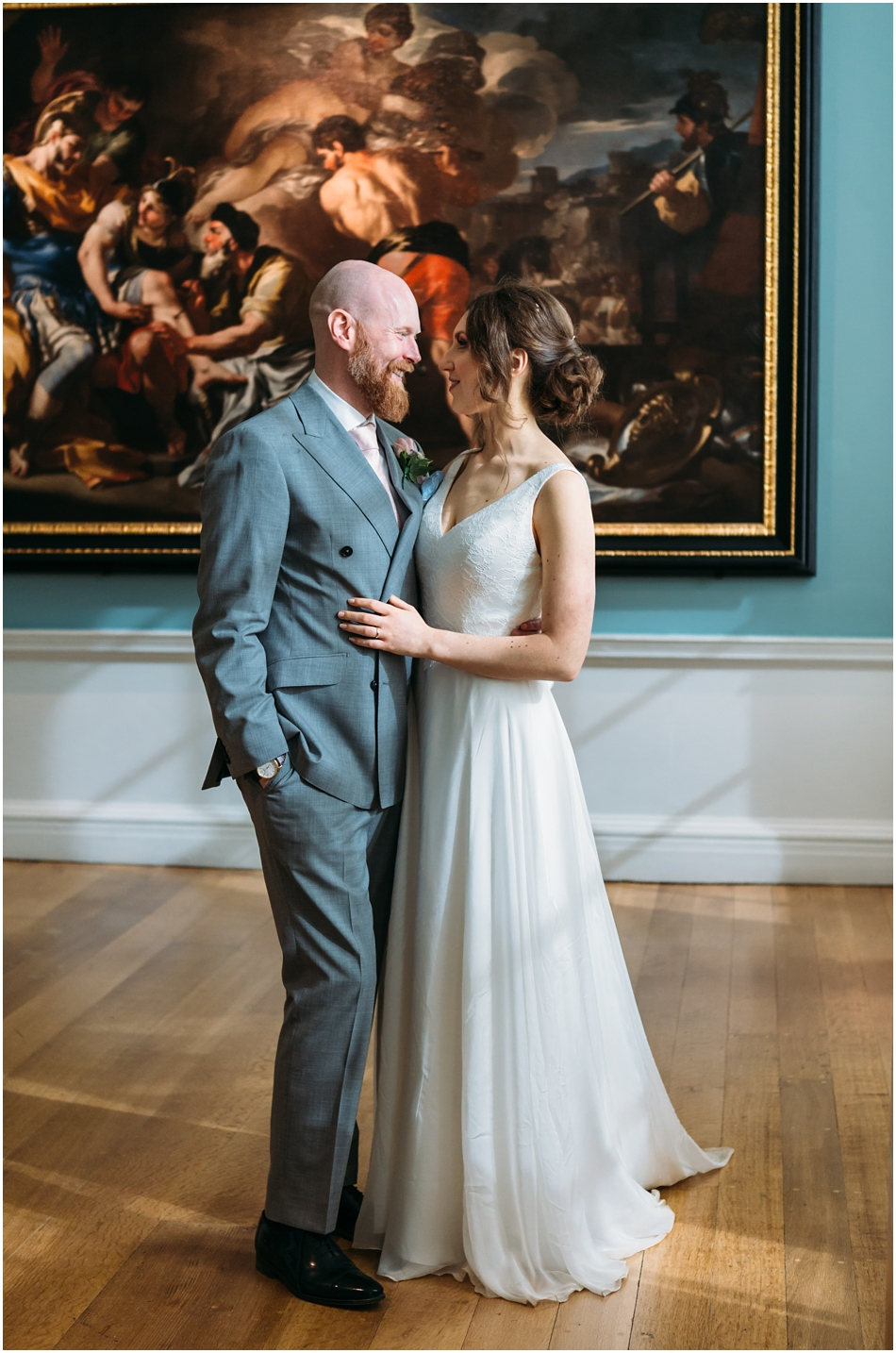 Compton Verney Wedding Photography; Bride and Groom portrait indoors in front of paintings