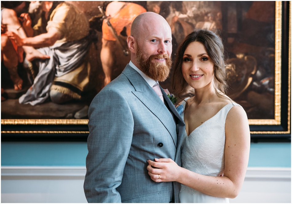 Compton Verney wedding photography; Bride and Groom portrait in front of art on their wedding day