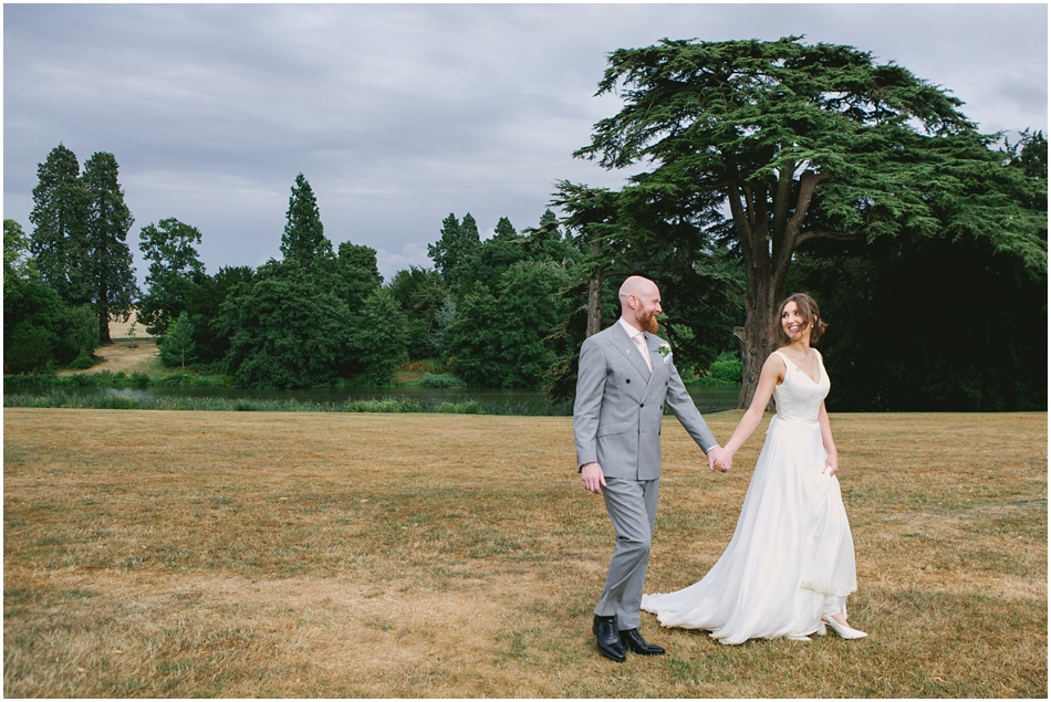 Bride and Groom walking in the grounds of Compton Verney