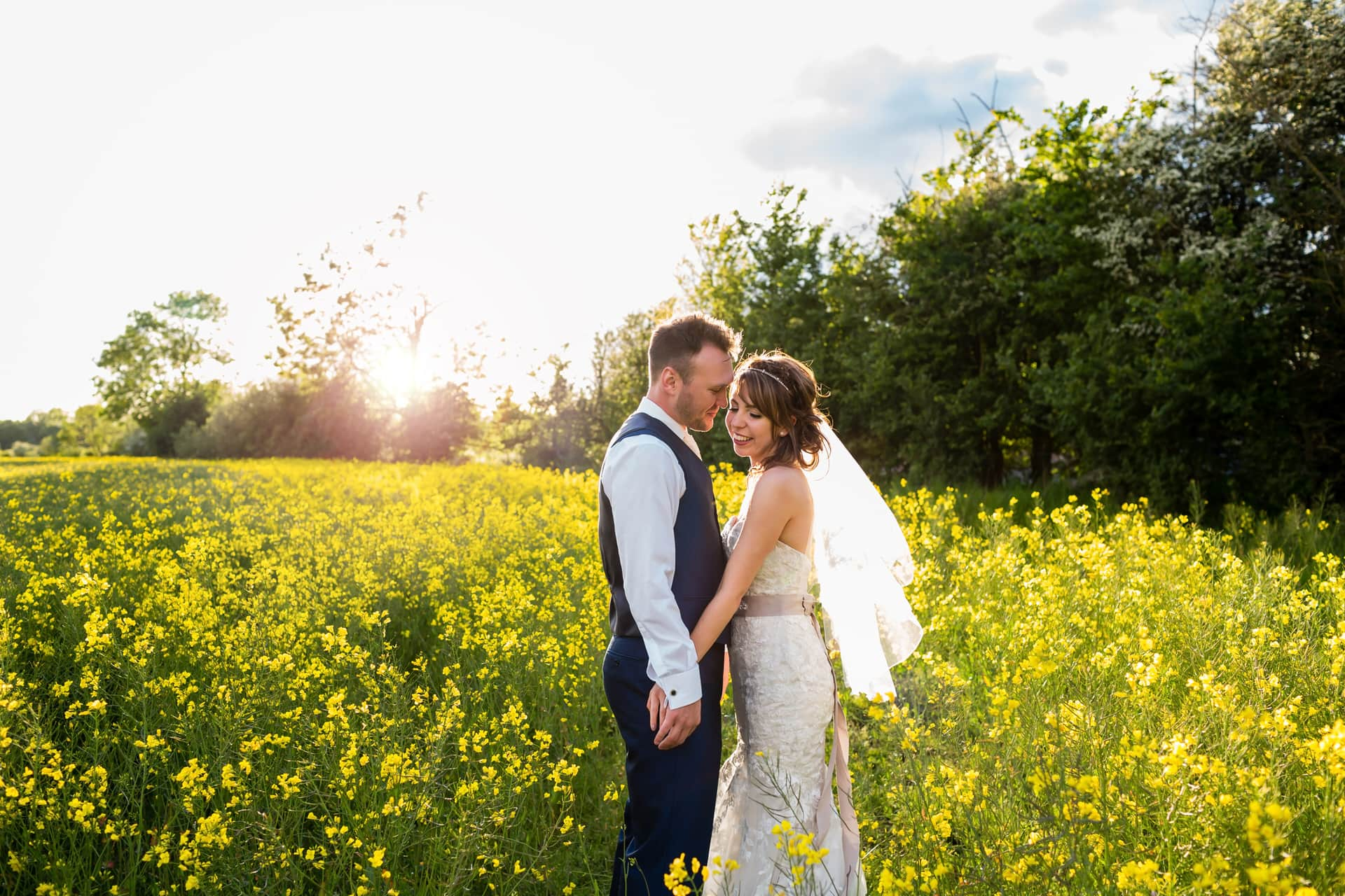 Couple in Rapeseed field at Shustoke Barn