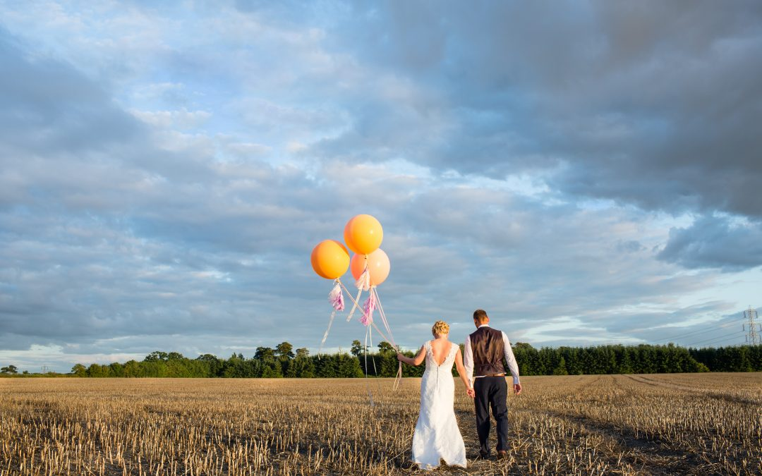 Shustoke Farm Barns Wedding with Giant Tassell Balloons