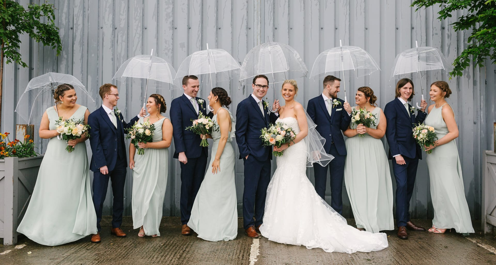 Bridal Party in the rain with umbrellas