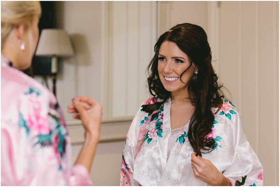 Bride and Bridesmaids wearing floral silk robes; getting ready for a romantic Iscoyd Park wedding