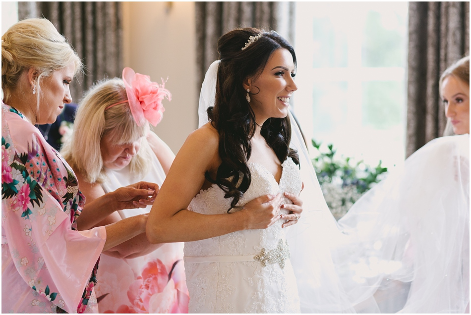 Bride getting ready in the Bridal suite, on the day of her romantic Iscoyd Park wedding