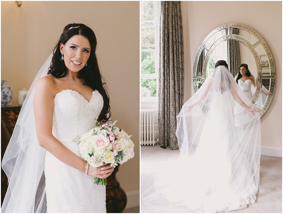 portrait of a Bride with long veil and bouquet of roses, at a romantic Iscoyd Park wedding