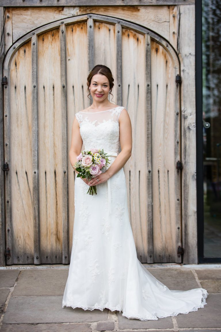Shustoke Barn wedding photography; Portrait of Bride infront of oak doors