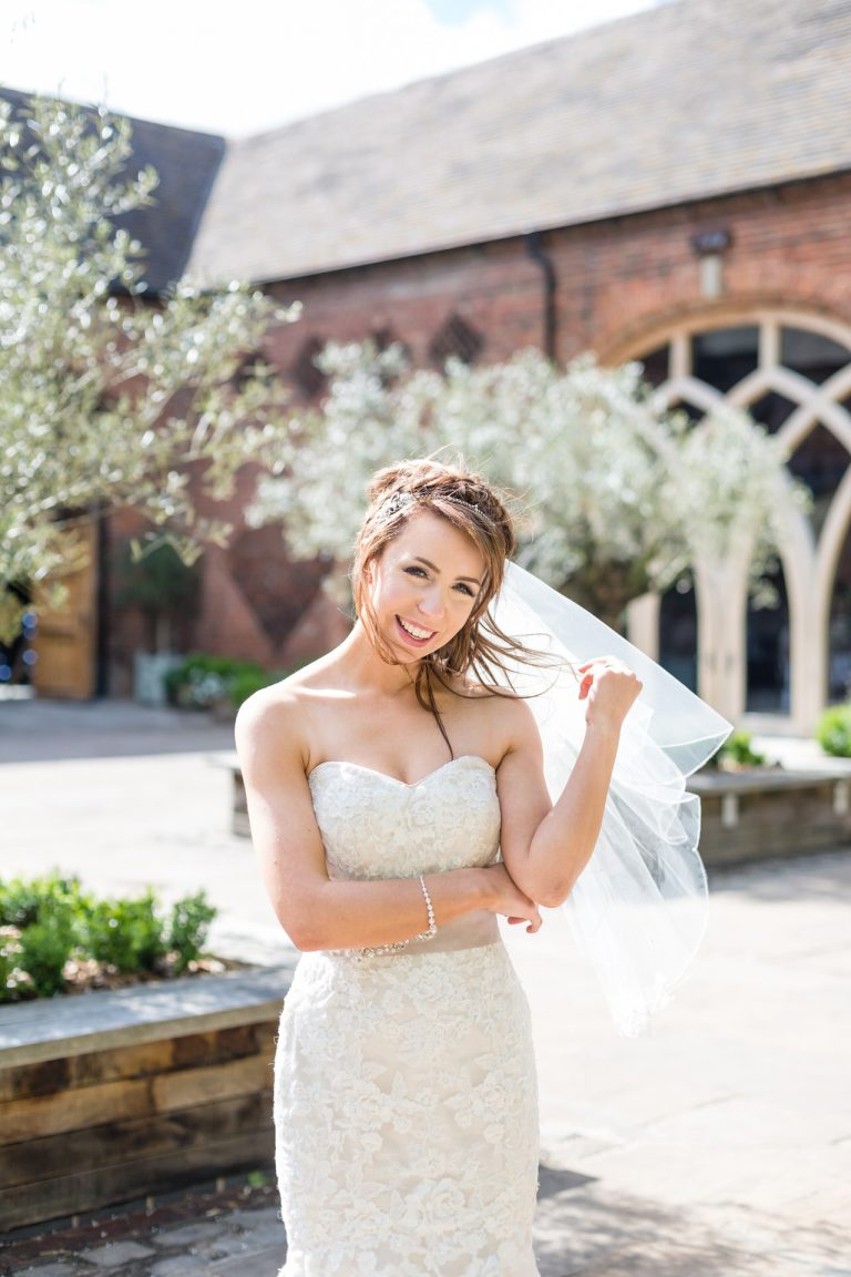 Shustoke Barn wedding photography; Bride in the courtyard