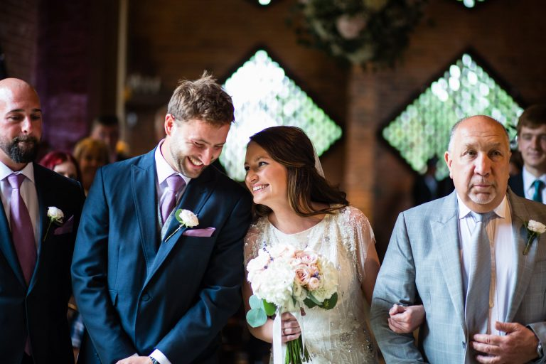 Shustoke Barn wedding photography; Bride and Groom in civil ceremony