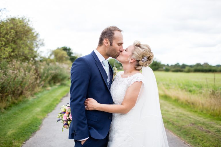 Shustoke Barn wedding photography; Bride and Groom kissing