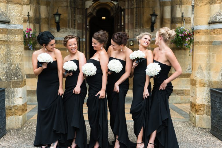 Ettington Park Wedding Photography; Bridesmaids in full length black dresses