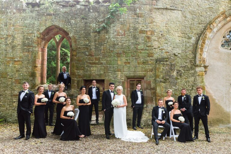 Ettington Park Hotel wedding photography; Bridal party photo in the chapel ruins at Ettington Park Hotel