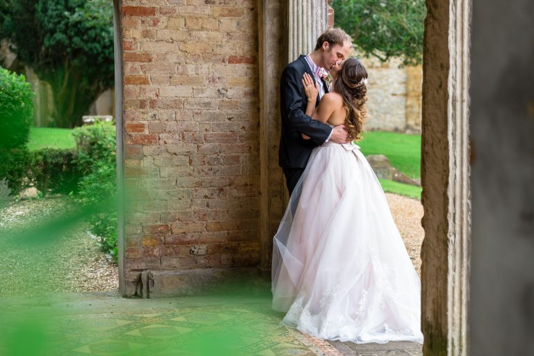 Ettington Park Hotel wedding photography; Bride and Groom kissing