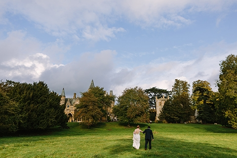 Couple walking in the grounds of Ettington Park Hotel