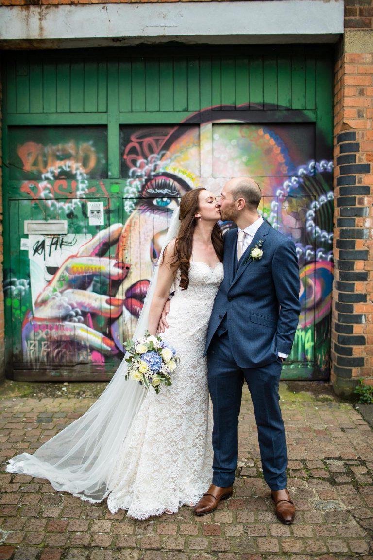 Bride & Groom kissing in front of Graffiti in Digbeth, Birmingham