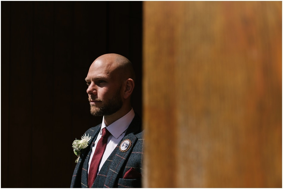 Portrait of a Groom on the wedding day, in the doorway at Hope Street Hotel