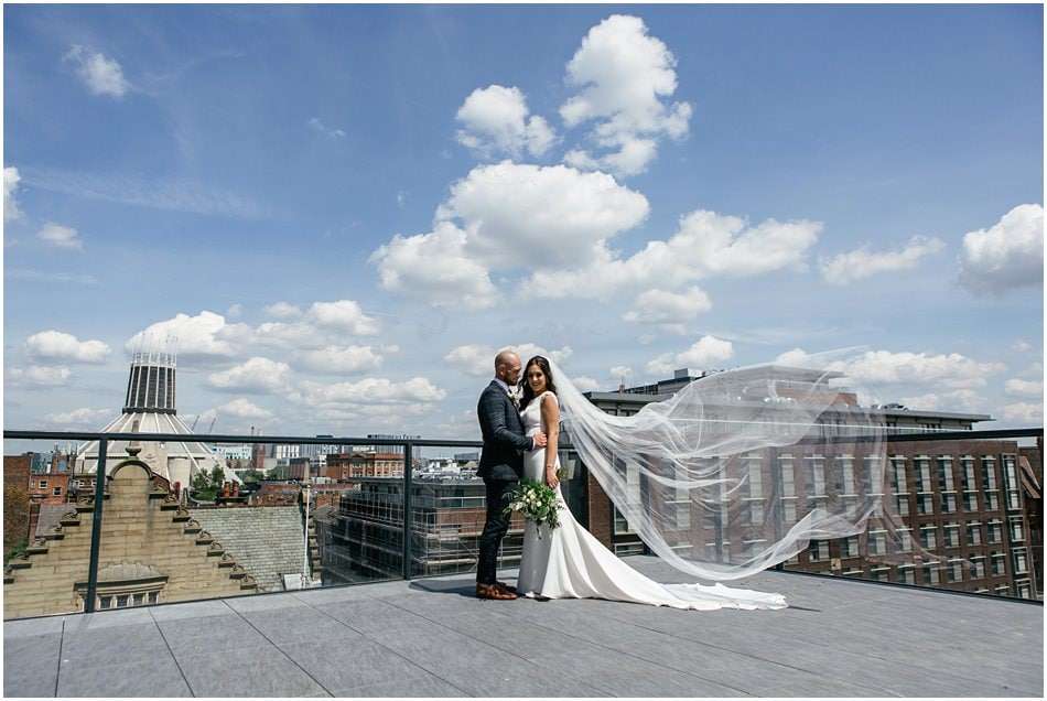 Modern Hope Street Hotel wedding photography; Rooftop portrait of Bride and Groom with veil blowing in the wind