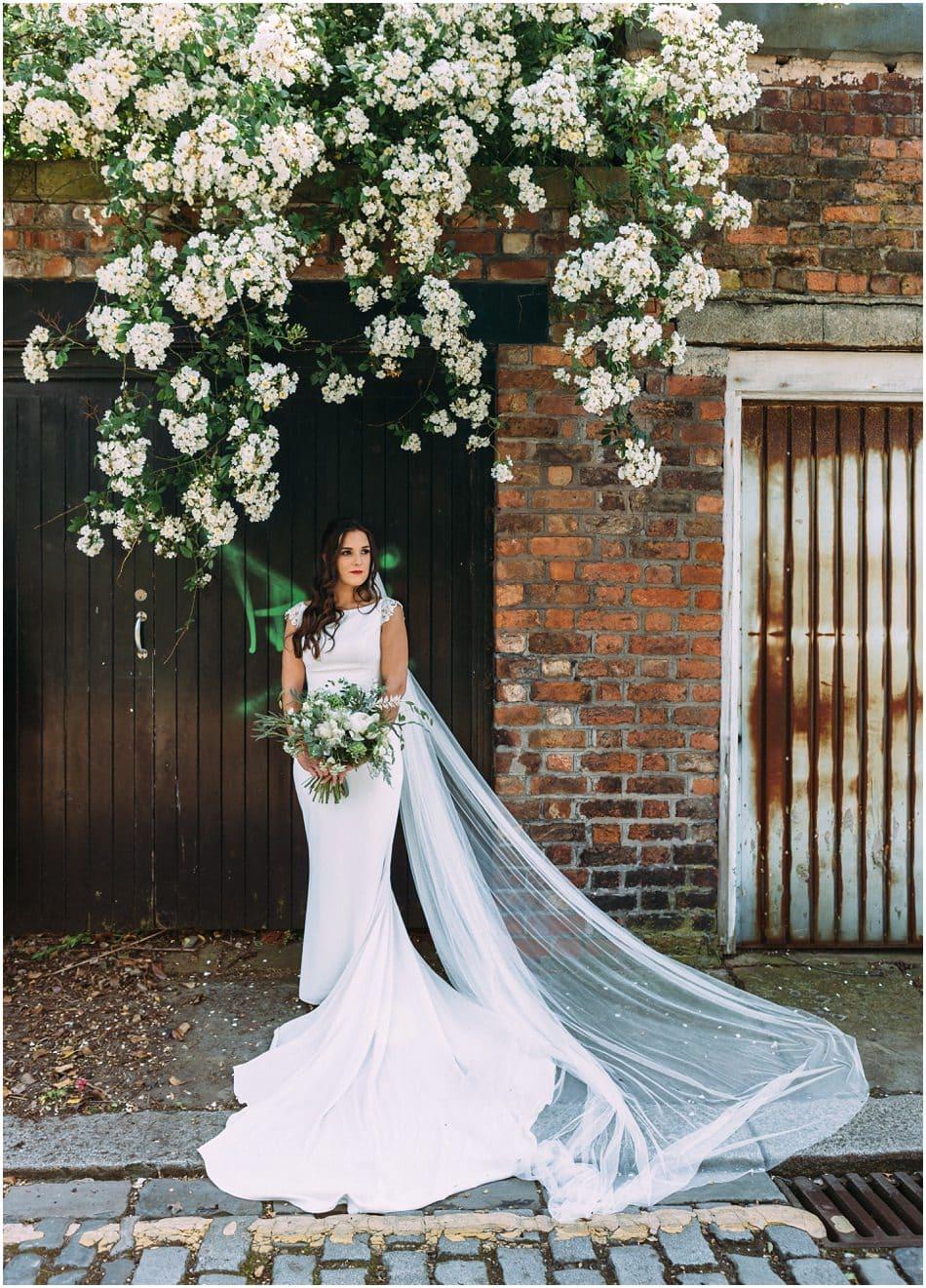 Siren Liverpool wedding photography; Bride with floor length veil