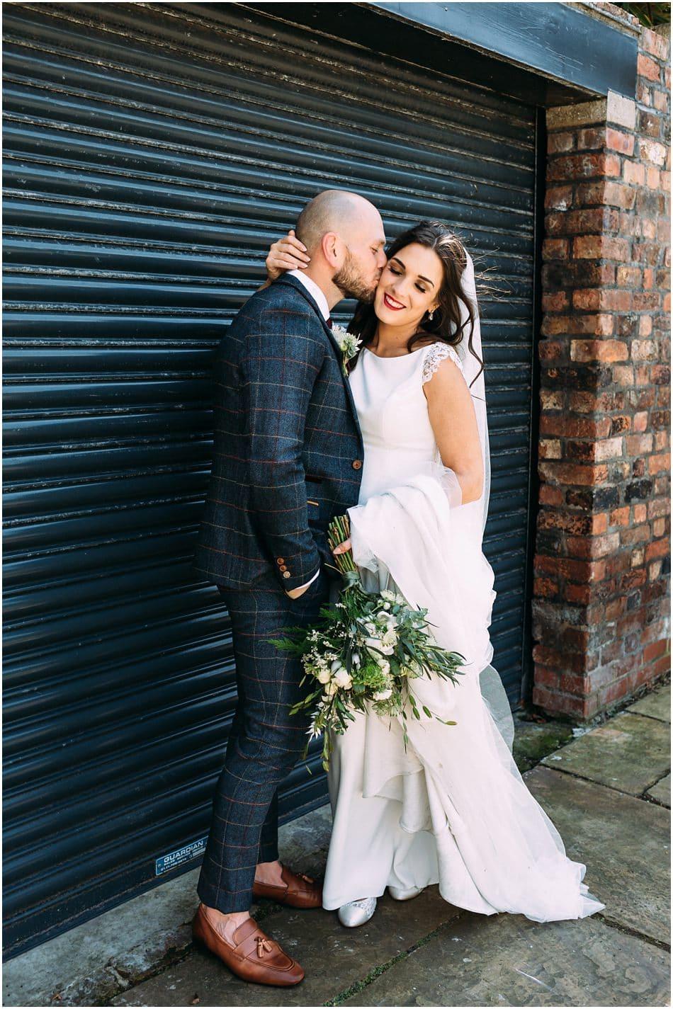 Alternative Hope Street Hotel wedding photography; Bride and Groom kiss