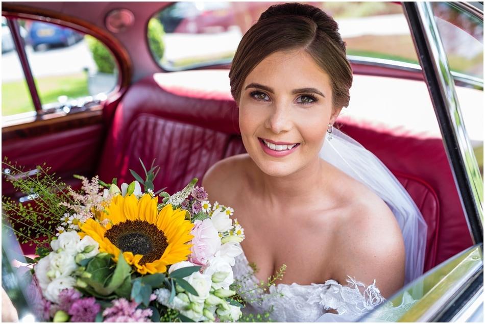 Bride arriving in wedding car at Shustoke Barn