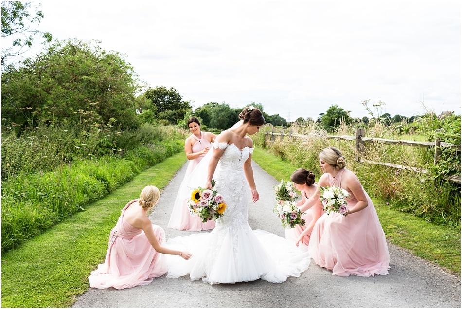 Shustoke Barn wedding photography; Bride with her Bridesmaids