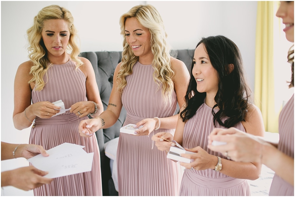 Bridesmaids receiving gifts; documentary wedding photography