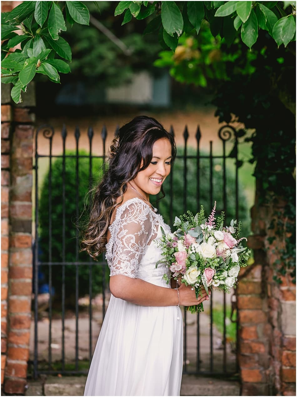 Gorcott Hall wedding photography; Bride wearing boho Dana Bolton wedding dress with pink and white rose bouquet