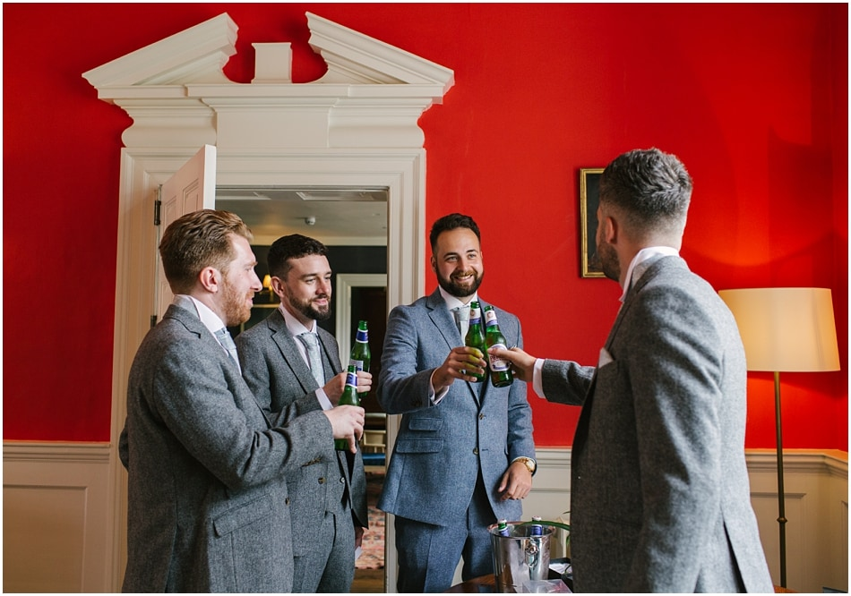 Iscoyd Park wedding photography | Groomsmen having a drink in the library