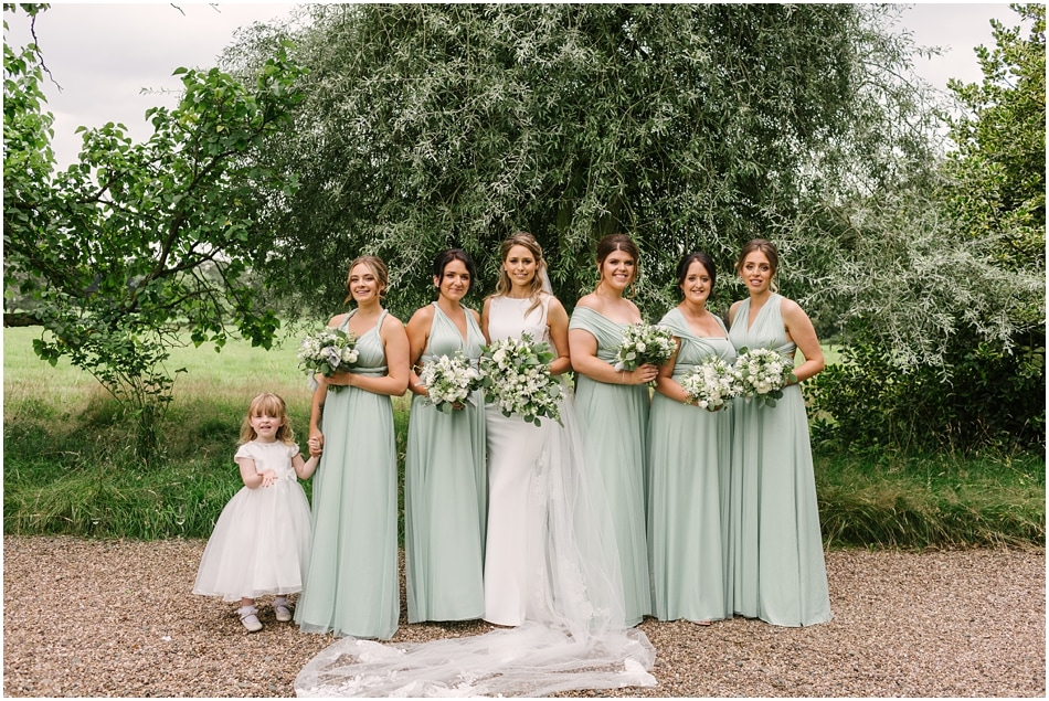Sage green mismatched wrap Bridesmaid dresses at Iscoyd Park wedding