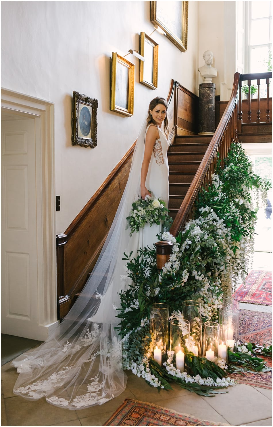 Bride on the stairs at Iscoyd Park