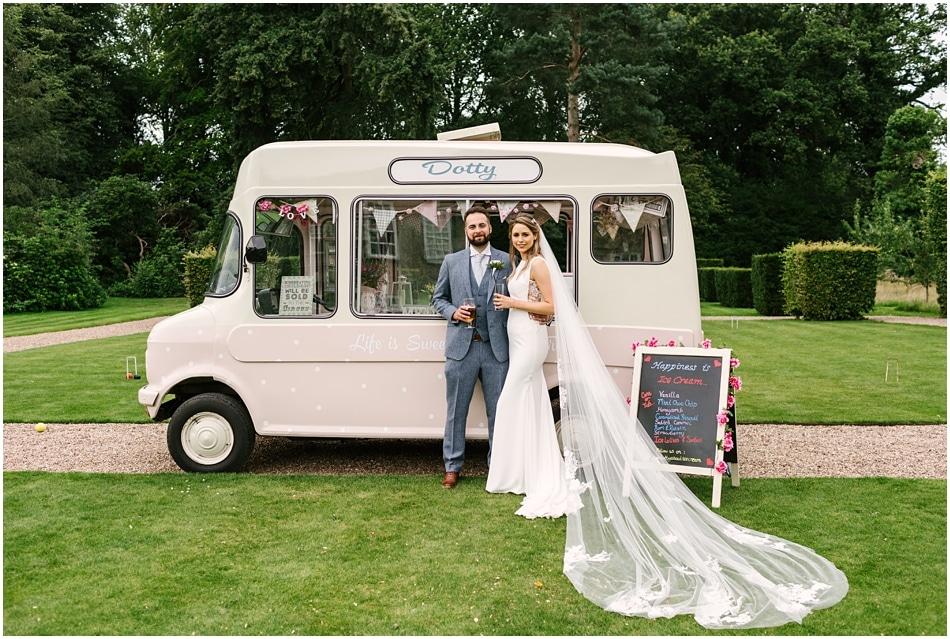 Pink vintage ice cream van with Bride and Groom at Iscoyd Park