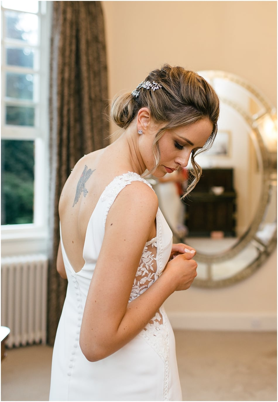 Pronovias fitted wedding dress with lace panel for an Iscoyd Park wedding