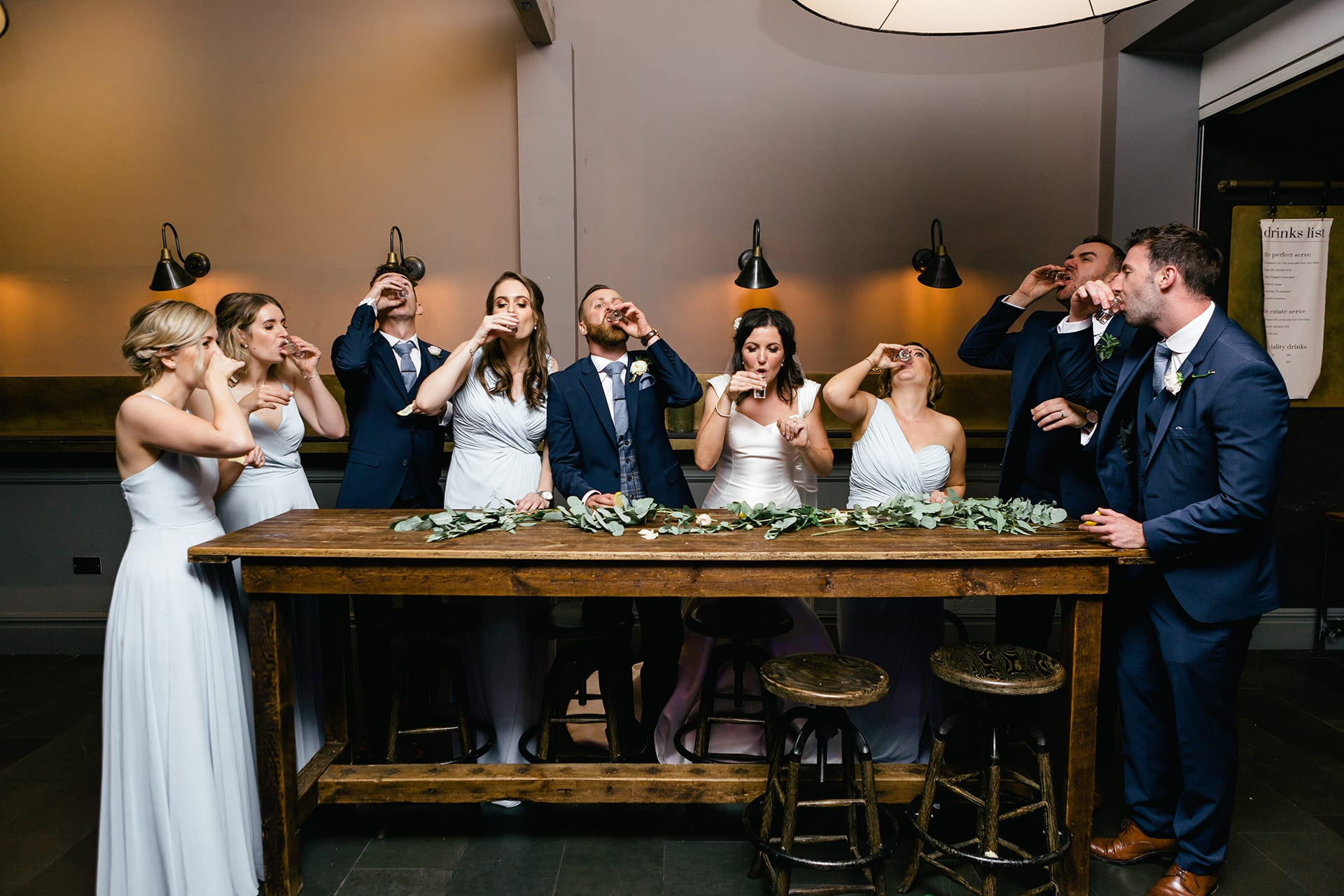 Hampton Manor wedding photography: Bridal party doing shots