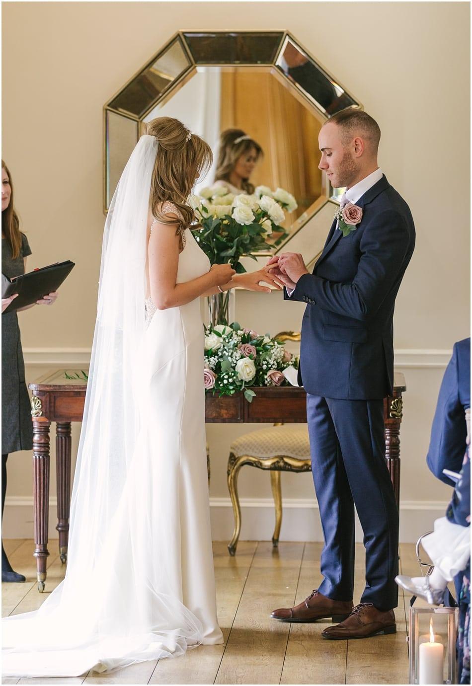 Exchanging wedding rings at an Alrewas Hayes wedding