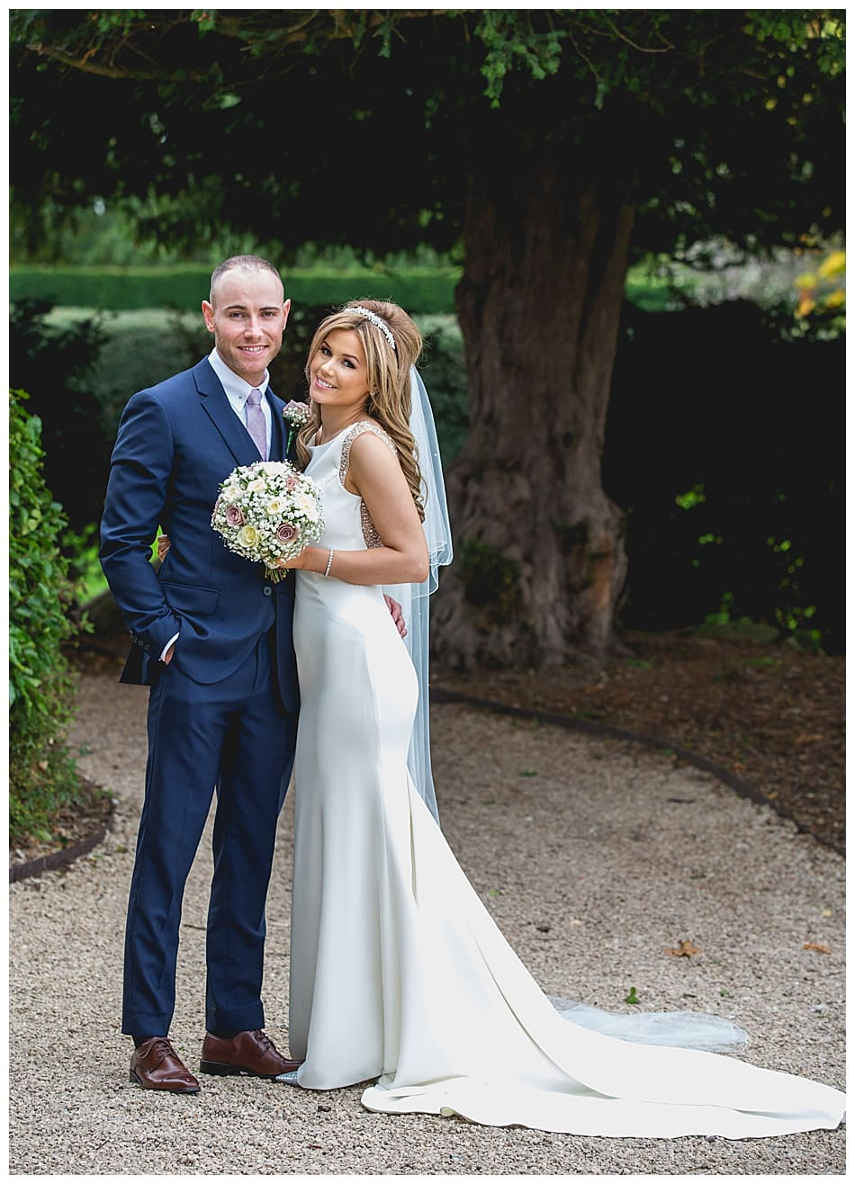 Bride and Groom in the gardens at their elegant Alrewas Hayes wedding