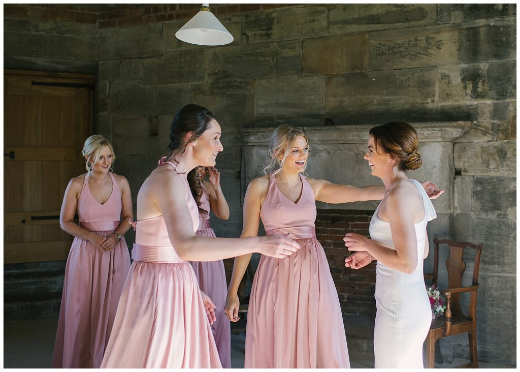 Bridesmaids seeing the Bride for the first time at Tixall Gatehouse