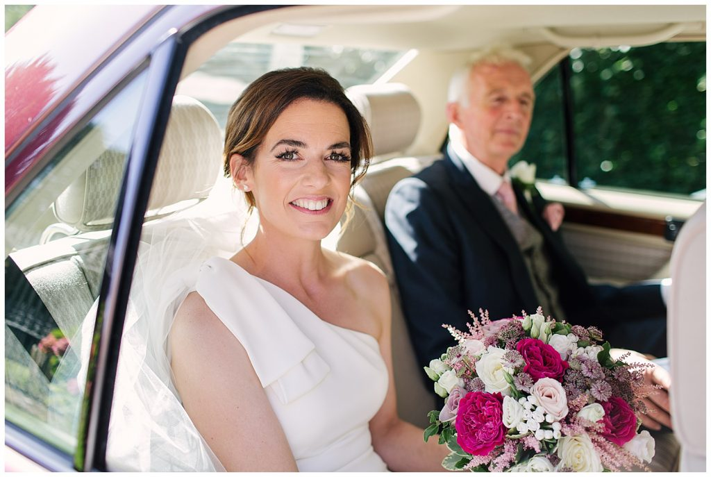 Bride arrives with Father for her wedding at Ingestre Church in Staffordshire